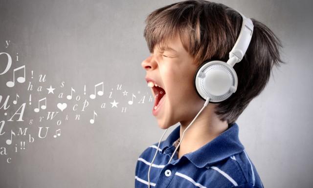child singing notes